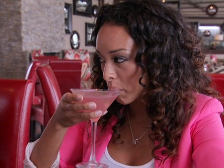 Gloria sips her drink, avoiding the drama at the mixology class.