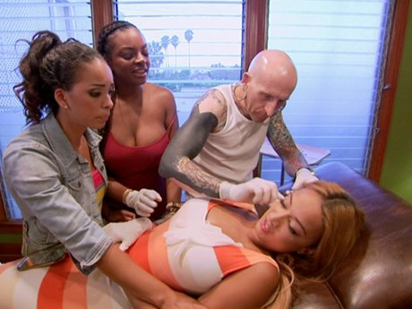 Gloria and Brooke support Draya during her piercing session.