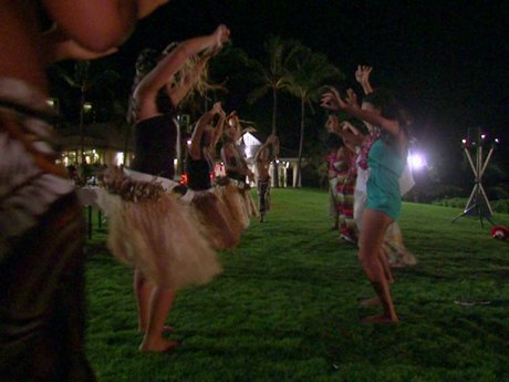 The girls practice their best hula moves.