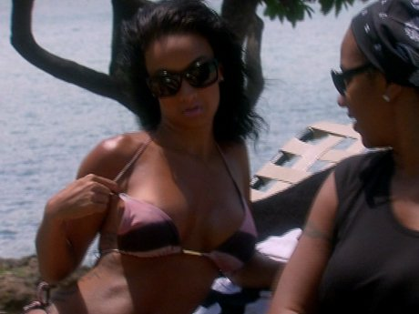 Draya shows her tan lines to the girls...and also shows off the girls.