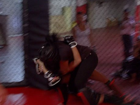 The girls take a tumble. Draya and Laura fight it out during their MMA class.