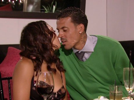 Matt and Gloria steal a kiss during dinner.