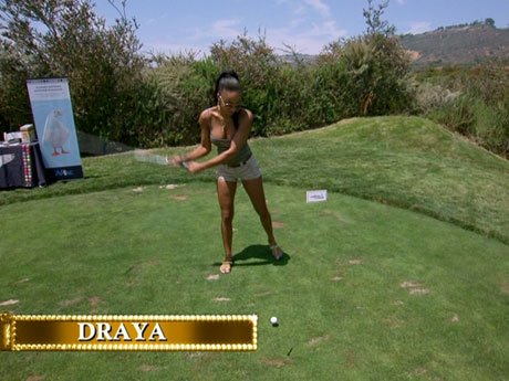 Draya attempts to make a hole in one.