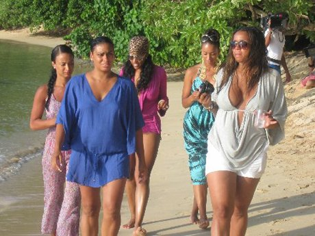 The girls enjoy a long walk on the beach.