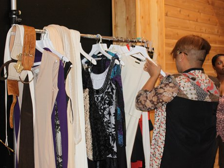 Shaunie's stylist, Mr. Bradshaw, checks out the wardrobe situation.
