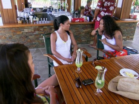 After Tami throws back a drink, she hands it to Kesha.