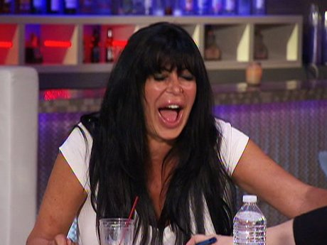 Big Ang blushes over all of the naked chests.