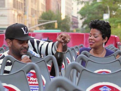 The two take a double decker bus through Manhattan.