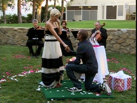 Since Shayne is a bit unconventional, he proposes with some beautiful, glittered, shoes.