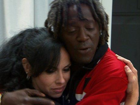 Flav hugs Liz after the drama.