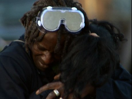 Flav embraces Liz after she takes her anger out.