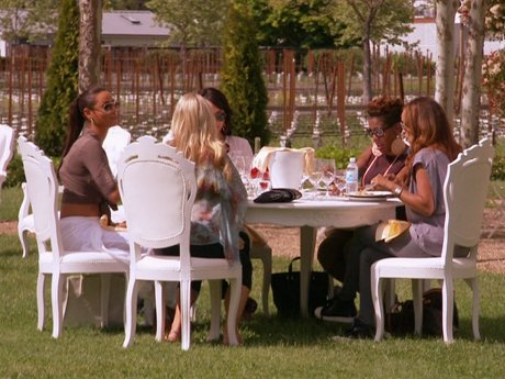 After their tour of the winery, the ladies enjoy a beautiful lunch amidst the vineyards.