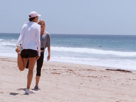Jessica and Nicole go out for a morning run on the beach.