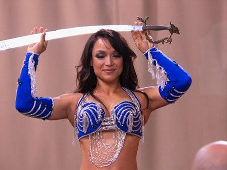 Mayte looks completely bad ass balancing this sword on her head.