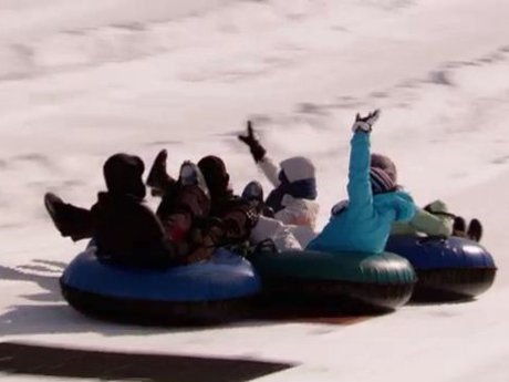 The girls go snow tubing.