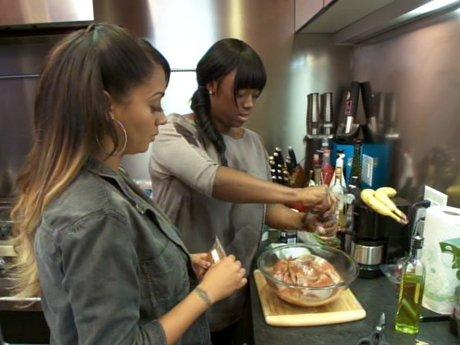 La La cooks with her friends.