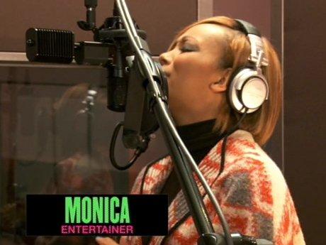 Monica belts it out in the studio.