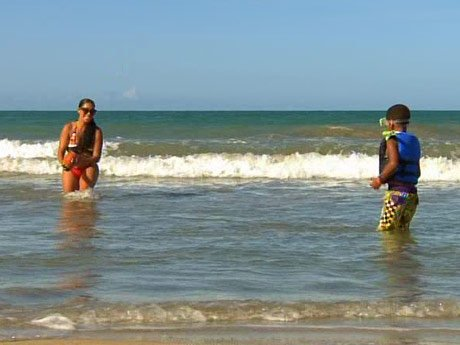 La La and Kiyan soak up the waves.