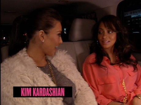 Basketball first Ladies La La and friend Kim Kardashian head to one of Carmelo's games.