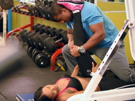 Yandy works out with help from her trainer/cousin.