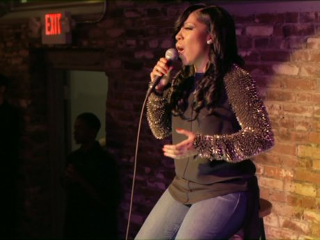 K.Michelle belts it out.