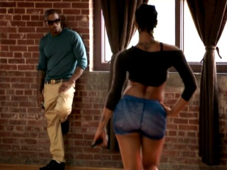 Joseline shows Stevie J her new dance moves.