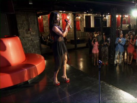 Rasheeda tries to work with the crowd at her listening party.