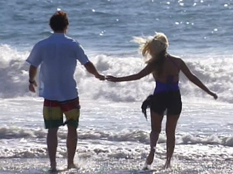 Brittany and Matt share a moment on the beach.