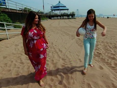 Karen and her daughter spend some quality time on the beach.