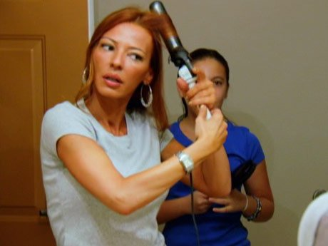 Drita gets ready to see her husband.