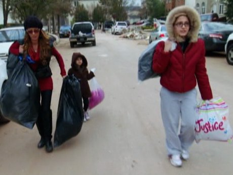 Drita and her daughters do what they can to help out.