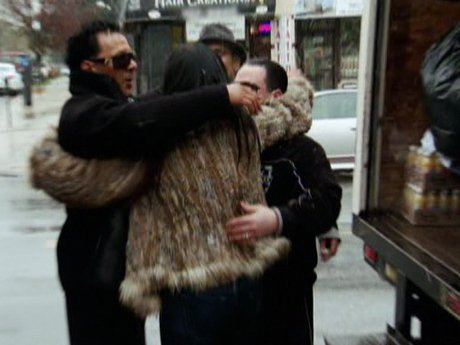 Big Ang gets some help transporting donations from the Bronx Boys.