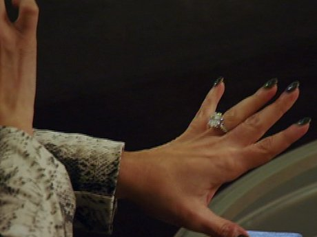 Ramona shows off her engagement ring.