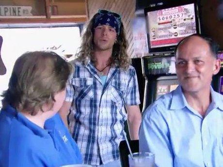 Josh belts a tune to restaurant patrons.