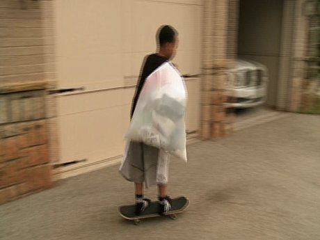 Domani takes out the trash on his skateboard - how efficient!