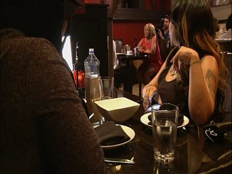 While Precious is working it on her date, Tiny and the girls are watching the date from a table nearby.