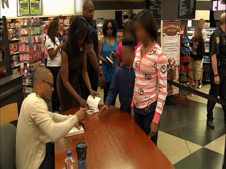 T.I. is hard at work at his book signing.