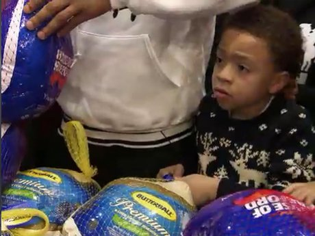 T.I. teaches the Harris kids to give back when they volunteer at T.I.'s Turkey Day Giveaway.