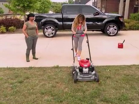 Tiny shows Shekinah how to mow the lawn.