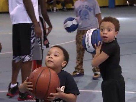 King and Major practice their basketball skills.