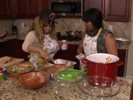 Tiny shows Shekinah how to cook her signature dish.