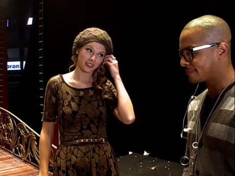 Taylor gives T.I. a rundown of the concert.