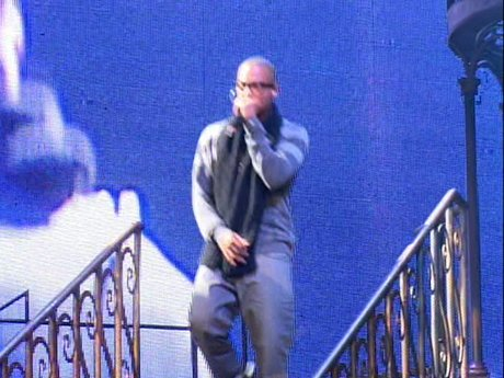 T.I. comes on stage - he may be rapping his lines perfectly, but he's still afraid he'll curse on stage!