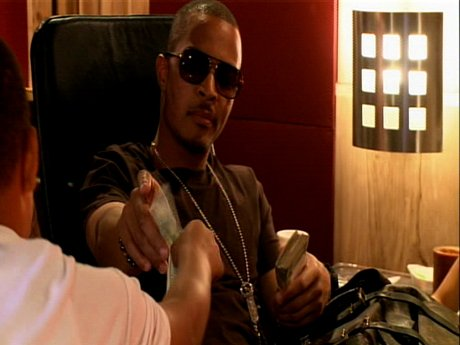 T.I. teaches his kids the value of the dollar, dollar, bills.