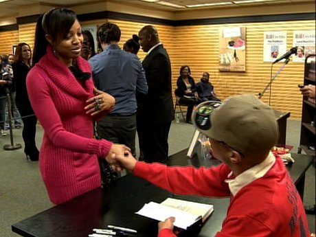"""T.I. does a book signing for """"Power and Beauty""""."""