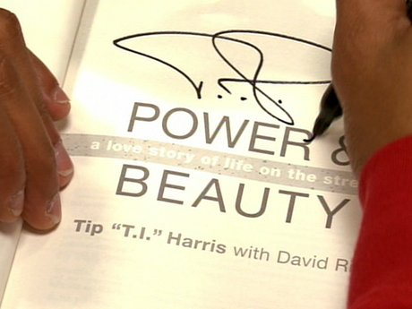 Look at that signature! T.I. gives out his John Hancock.