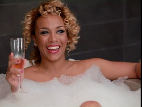 Kim is bathing in the bubbles with some bubbly!