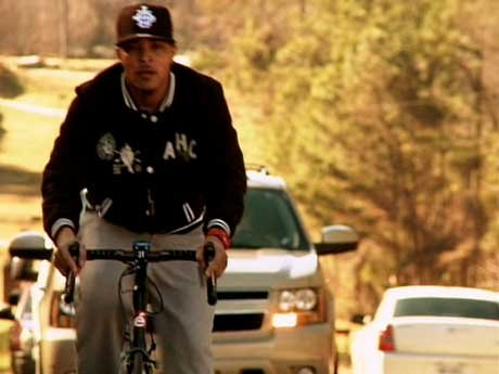 What's the hold up? T.I. decides to go uphill by himself, but he may have annoyed a couple of drivers along the way.