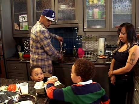 Oh the usual - T.I. brings several wads of cash to the kitchen table.