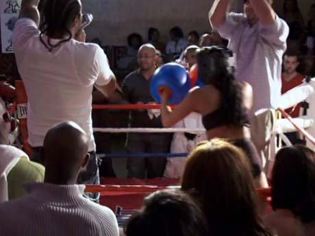 Jim Jones hosts an all girls half nekked boxing match.